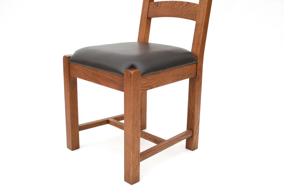 solid american oak chairs with dark brown or black leather pads