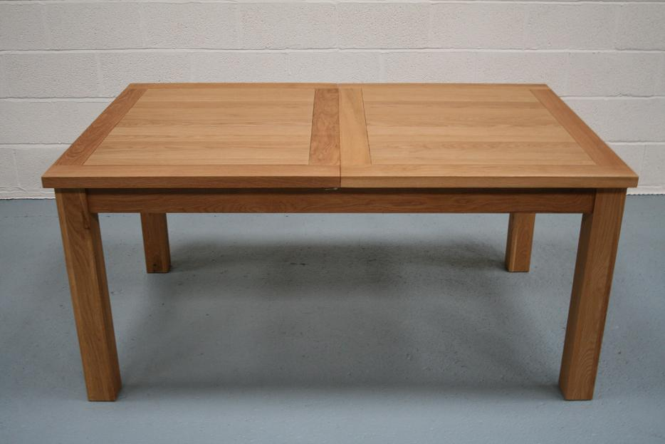 Lichfield extending dining tables 8 seater oak dining for Best extendable dining table
