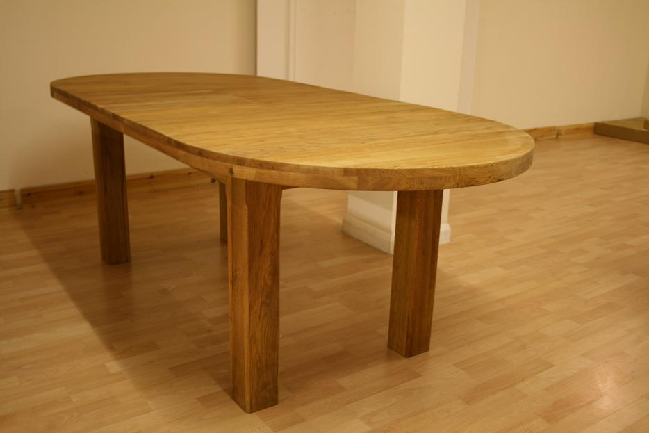 Round dining table extending round oval dining table for Oval dining table