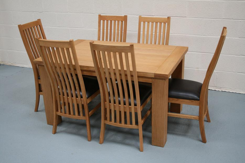 82c3f351ca Riga 1.4m Oak Table with 6 Lichfield Solid American oak chairs and brown  leather pads. Special set price of just £699 !