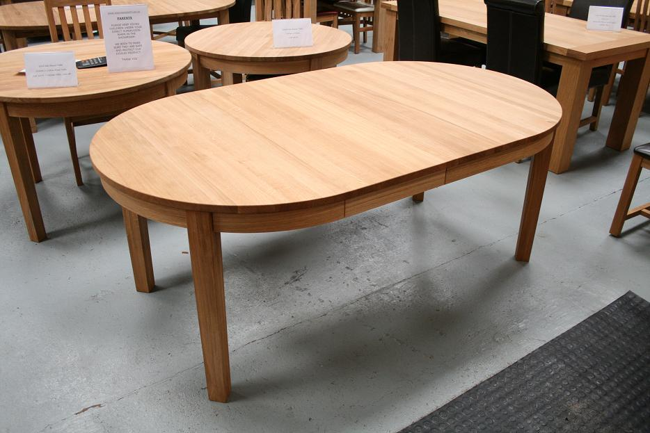 The Fully Extended 1.1   1.9m Round Extending Table With Both Central  Extensions In Place. Rounded Side Skirts At To The Beauty Of This Design.