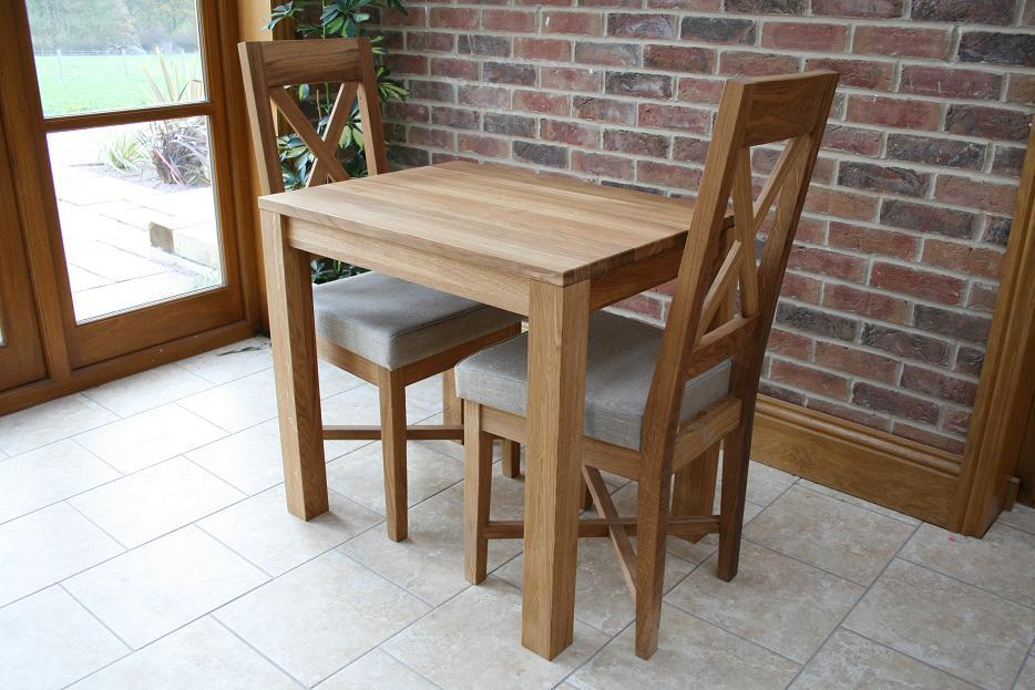Solid oak kitchen tables chairs cheapest prices for Small 4 person dining table