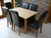 Minsk solid oak table shown with Brown Emperor chairs
