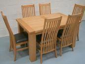 1.8m Riga oak table @ �299 and �84.99 Lichfield solid American oak chairs