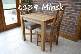 The �139 80cm x 60cm solid European oak Minsk dining table.  Even the Chinese cant match this price !